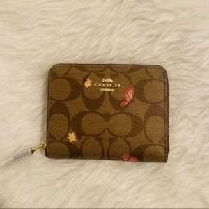 Tan pink signatures logo butterfly wallet coach